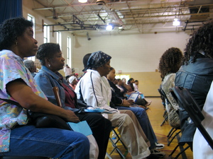 Rosie EuRosie Eubanks and her sister listen for details at a meeting with the Chicago Housing Authorityon what will happen at LeClaire Courts, a public housing complex